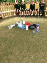 Primary 2/3 having fun in the sun learning about Capacity